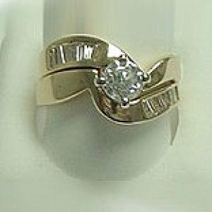 https://amajewellery.ca/wp-content/uploads/2017/05/Diamond-Ring-With-A-Twist-300x300.jpg